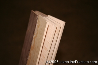Four similar slices of wood