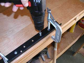Attaching the rails with screws.
